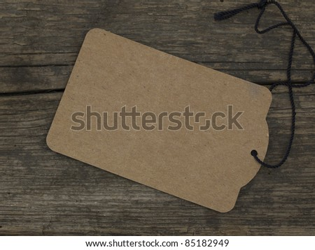 tag on the wooden background - stock photo