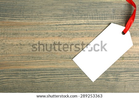 Tag sale on a wooden background - stock photo