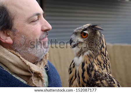 TAGGIA, ITALY - FEBRUARY 27: Patrizio Merelli - Falconer of Italian Federation Historical Games in a performance demonstration of training the European eagle owl in Taggia, Italy on February 27, 2010. - stock photo