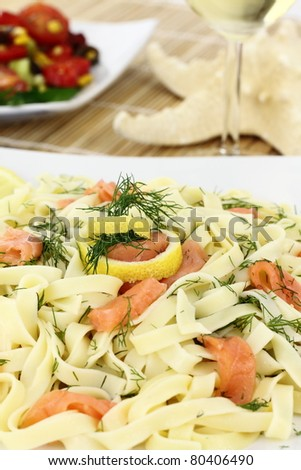 Tagliatelle pasta with salmon, anise and lemon - stock photo