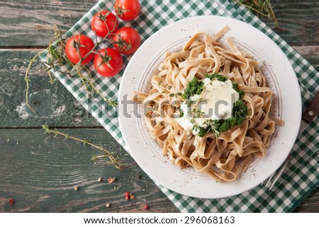 Tagliatelle pasta with spinach and fresh thyme - stock photo