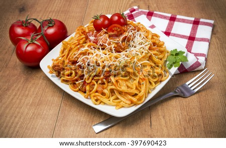 Tagliatelle whit tomato sauce - stock photo