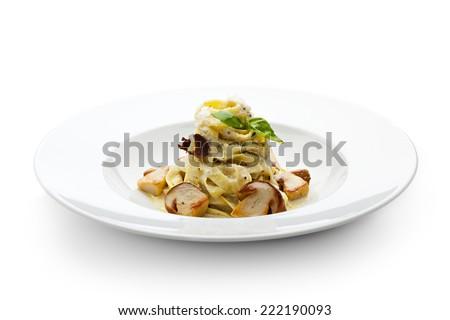 Tagliatelle with Mushroom, Cream Sauce, Truffle and Basil Leaf - stock photo