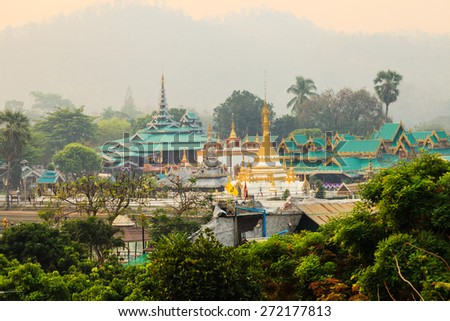 Tai Yai style temple at Maehongsorn Province, Thaland, in the morning mist - stock photo