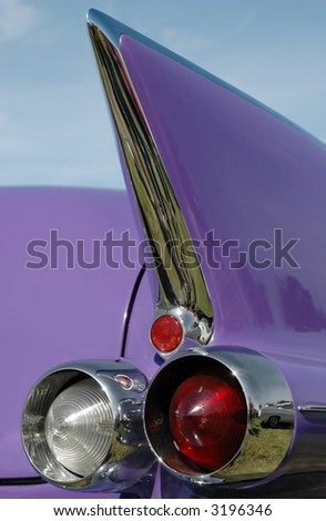 tail fin from a classic american car - stock photo
