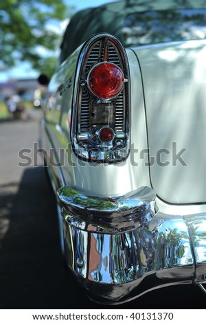 Tail-light and bumper of antique car - stock photo