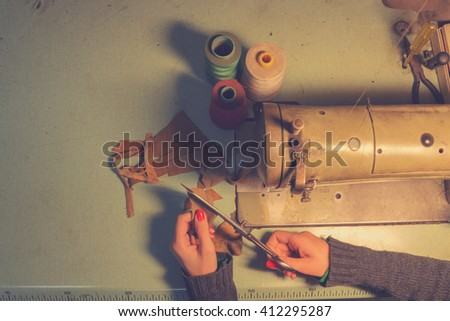 Tailor in her retro shop. - stock photo