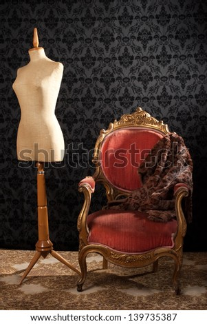 Tailor mannequin and armchair on a vintage background - stock photo