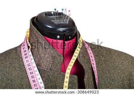 tailoring of man tweed jacket on dummy isolated on white background - stock photo