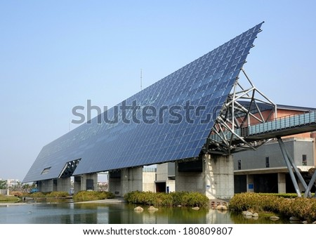 TAINAN, TAIWAN -- MARCH 4, 2014: A giant wall of solar panels is a distinctive feature of the National Museum of Taiwan History in Tainan City which was completed in 2012. - stock photo