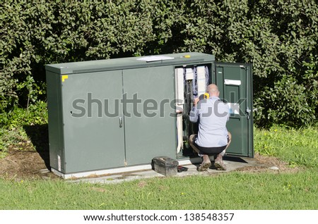 TAIPA, NZ - MAY 09:Chorus service technicians maintains the Network on May 09 2013.Chorus is New Zealand's largest telecommunications infrastructure company. - stock photo
