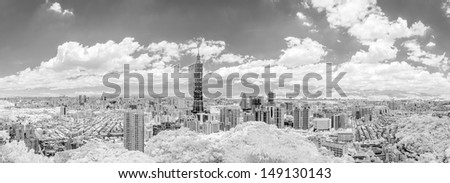 Taipei cityscape with dramatic clouds at sky, infrared photography in black and white. - stock photo
