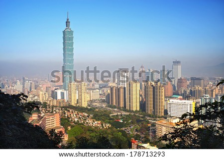 TAIPEI, TAIWAN - FEBRUARY 25: Taipei skyline on February 25, 2014 in Taipei, Taiwan. The city is under heavy air pollution and dusty.  It is a hazy sunny day.   - stock photo