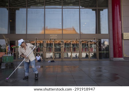 Taipei, Taiwan - Jun 5: The janitor is cleaning the floor of Liberty Square with Chiang Kai-shek Memorial Garden in Taipei , Taiwan on June 5 2015.  - stock photo