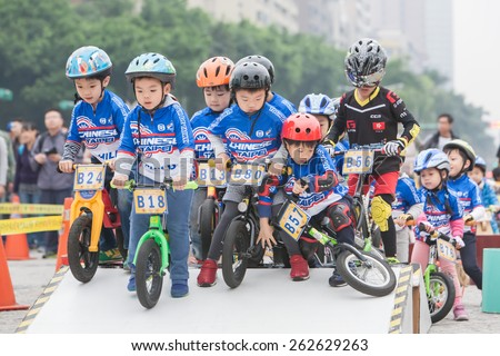 TAIPEI, TAIWAN, MARCH 22 2015, Tour de Taiwan, the International Cycling Road Race. first stage is Taipei city. Also held the Kid's Push Bike road race. - stock photo