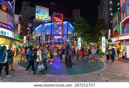 TAIPEI, TAIWAN - May 1 : Locals and tourists walking at the Ximending street market in Taipei, Taiwan on May 1, 2015 .This street is the gathering place for youngster in Taipei. - stock photo