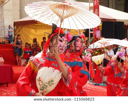 TAIPEI, TAIWAN-OCT 4: Twelve Grannies Parade, a kind of  traditional Chinese entertainment, is performed in the Northern Taiwan Mazhu Festival in Taipei, Taiwan on October 4, 2012. - stock photo