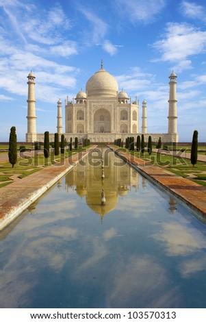 Taj Mahal at sunrise, reflecting in the pond. India. - stock photo