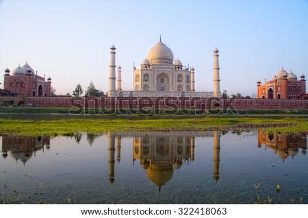 Taj mahal back view,reflection in river - stock photo
