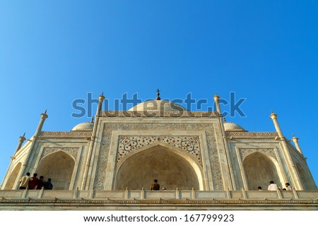 Taj Mahal front with reflection in water - stock photo