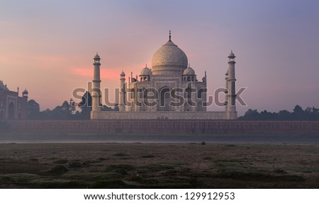 Taj Mahal in sunrise light. Early in the morning, back view from outside, river side. One of the most famous building in the world. This mausoleum was built in 1631. - stock photo