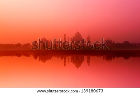 Taj Mahal India. Indian palace Tajmahal with reflection in Yamuna river water. Majestic nature landscape - stock photo