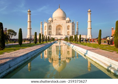 Taj Mahal on a bright and clear day at sunset, reflects in the pond. - stock photo