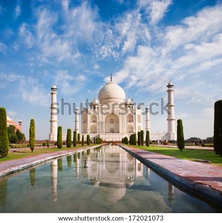 Taj Mahal on a sunny day with beautiful sky - stock photo