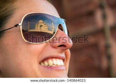 Taj Mahal reflected on woman�´s sun glasses. - stock photo