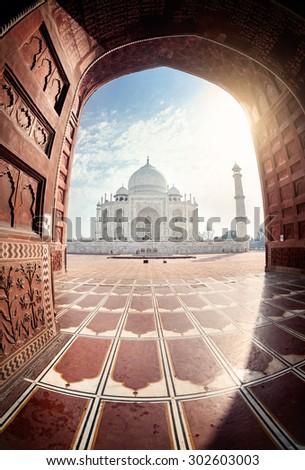 Taj Mahal view from the mosque through the arch in Agra, Uttar Pradesh, India - stock photo