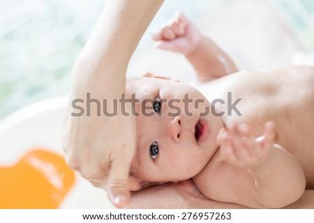 take a bath infant,asian baby - stock photo