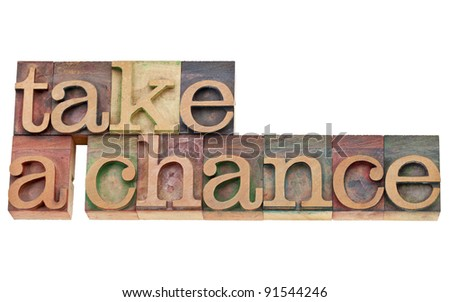 take a chance encouragement  - isolated text in vintage wood letterpress type, stained by color inks - stock photo