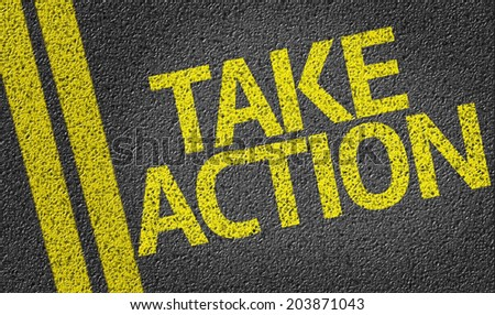 Take Action written on the road - stock photo