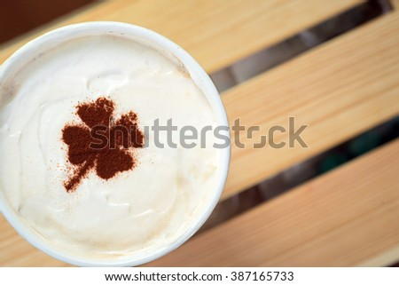 take away cup with shamrock symbol on coffee skin - stock photo