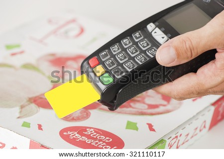 Take away Pizza payment with credit card through terminal - stock photo