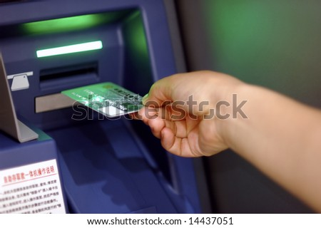 Take cash from the ATM - stock photo