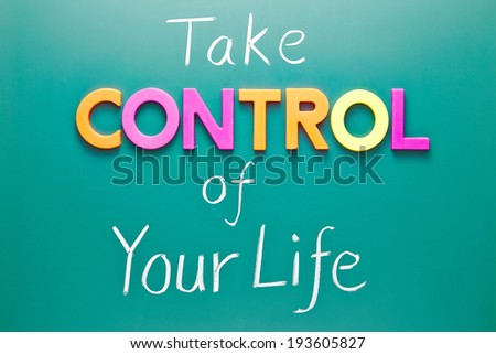 Take control of your life concept, colorful words on green blackboard - stock photo