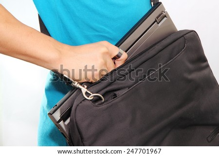 Take laptop to the bag / laptop's bag - stock photo