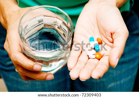 Take medicine and water - stock photo