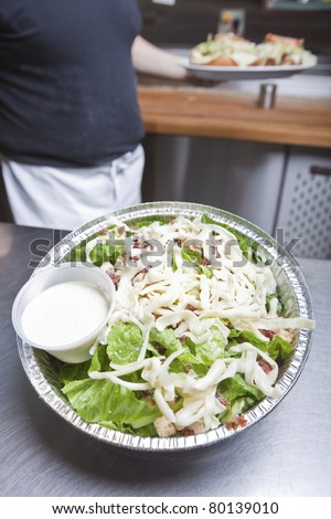 Take out caesar salad - stock photo