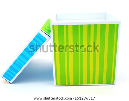 Take the Lid Off Box.  The lid rests next to a colorful striped box figuratively revealing a set of previously concealed problems. - stock photo