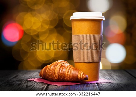 Takeaway coffee in a paper cup - stock photo