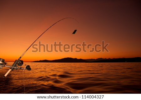 Taken of the coast of Vancouver, this fishing road has been retired for the day as the sun sets in the distance. - stock photo