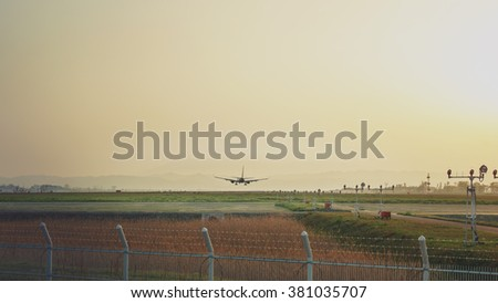 Takeoff in the thickening dusk - stock photo