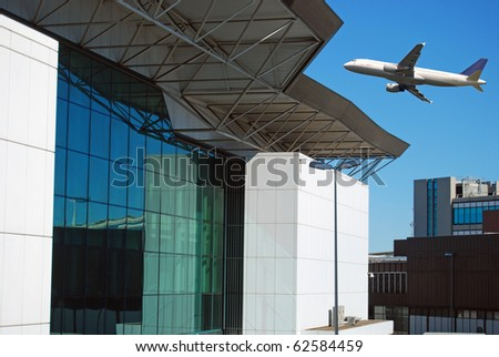 Takeoff of an airplane and architecture of the airport of Fiumicino - stock photo