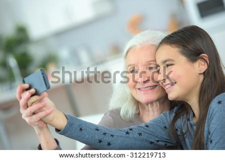 Taking a photo with grandma - stock photo
