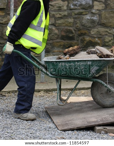 Taking away the rubble - stock photo