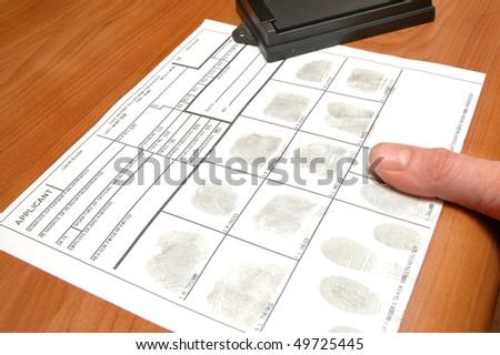 taking fingerprints on ID card - stock photo