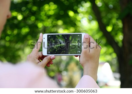 Taking picture of nature with smart phone - stock photo