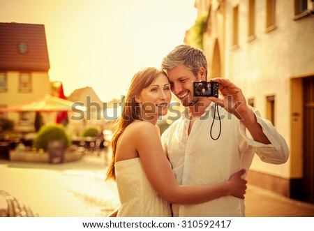taking pictures on the street while sun goes down - stock photo